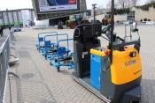 Electric tractor shunting backwards with three trailers