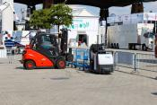 Driverless forklift loads automated trailers