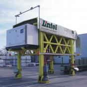 Automatically-driven stacker crane with GPS navigation