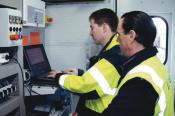 Commissioning automatic track guidance in the E-house of a container crane